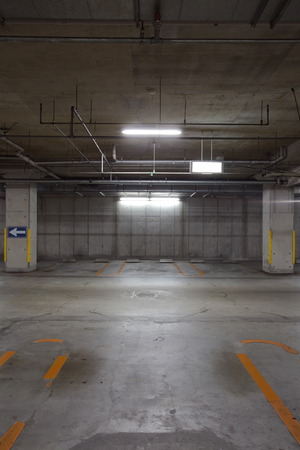 Empty underground parking background with copy space photo