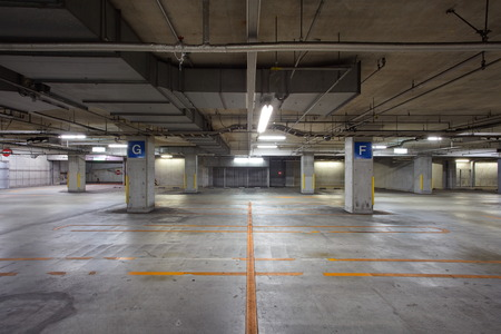vacant sign: Empty underground parking background with copy space Stock Photo