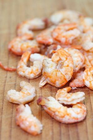 Uncooked food dried shrimp on wood photo