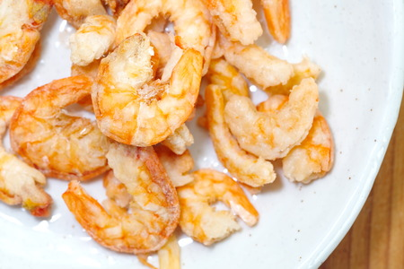 Uncooked food dried shrimp on  plate photo