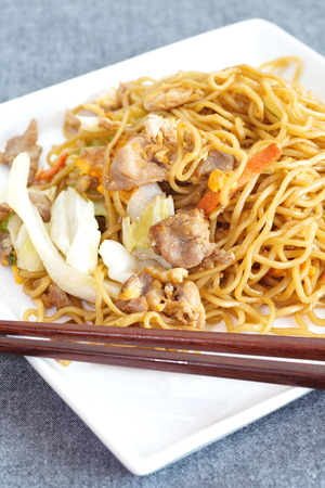 Chinese food stir - fried noodles with pork and vegetables photo