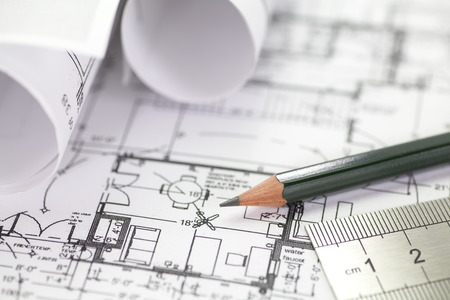 Architect rolls and plans construction project drawing photo
