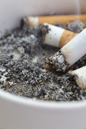 ashtray full of cigarettes close - up photo