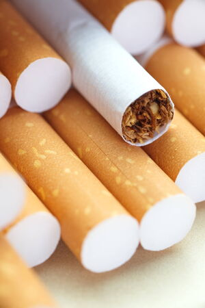 Cigarettes with a brown filter close - up photo