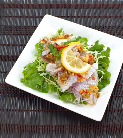 Hot and spicy steamed fish in lemon sauce photo