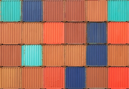 stacked of freight shipping containers at the docks  photo