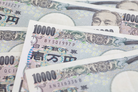 yen note: close - up japanese currency yen bank note and coin