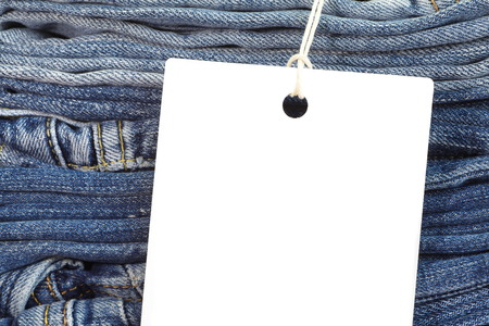 Close - up Blue jeans detail with blank white tag photo