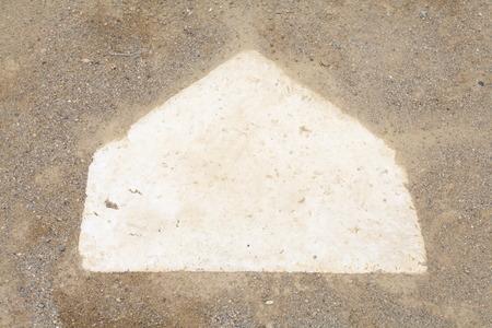 homeplate: close - up Baseball homeplate from baseball field