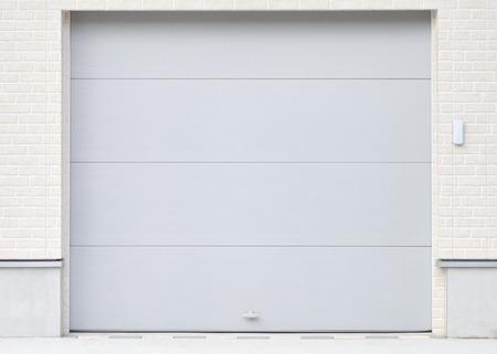 Illuminated grunge metallic roller white shutter door photo