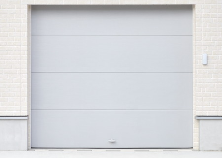 Illuminated grunge metallic roller white shutter door photo