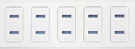 Close - up white extension power strip photo