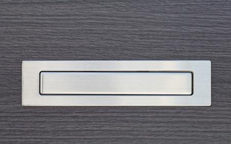 Metal post box and modern wood door photo
