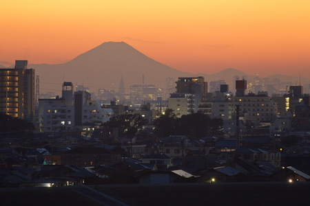 Mountain Fuji and sunset sky with Tokyo suburb in foreground photo