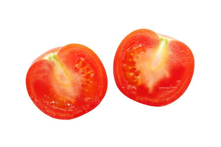 Fresh slice cherry tomatoe scattered isolated on a white background photo