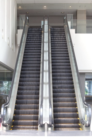 Empty escalator stairs in the modern office photo