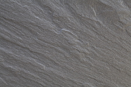 Black warm limestone rock texture and background Stockfoto