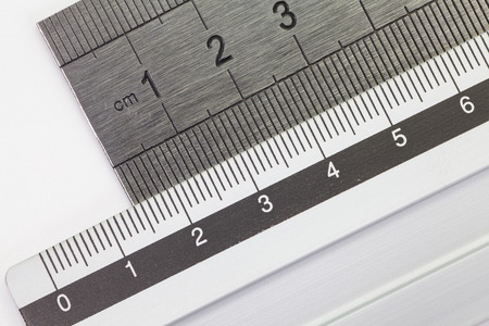 Stainless steel ruler isolated on white background photo