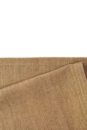 Brown canvas tablecloth isolated on white background photo