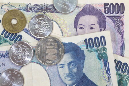 yen note: close up japanese currency yen coin and bank note