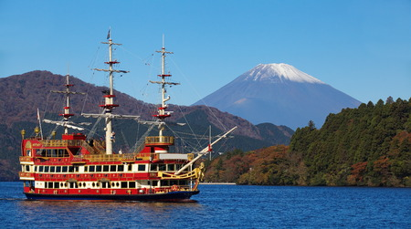 Sightseeing ship at lake Ashi and Mountain Fuji in background