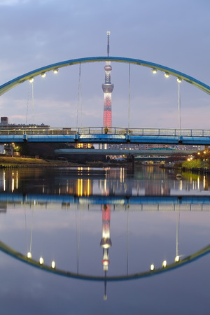 oshiage: Tokyo sky tree in red light up and reflection Editorial