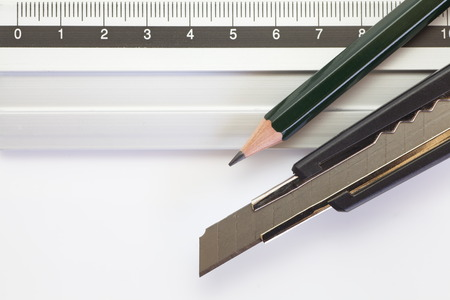 education concept: Pencil , knife cutter and Stainless steel ruler for education concept