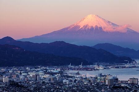 blue mountains: Shizuoka city town and Mountain Fuji at sunset Stock Photo