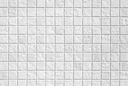 White mosaic tile wall seamless background and texture photo