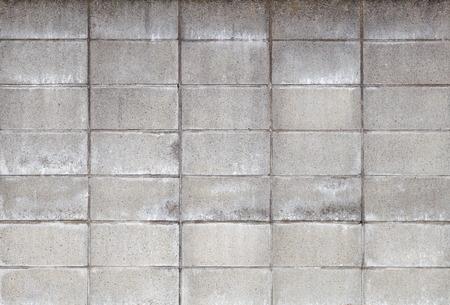 コンクリート ブロックの壁の質感とシームレスな背景
