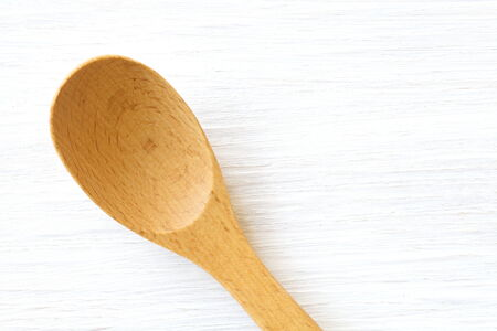 Wood brown spoon on white wood table background photo