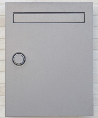 letterbox: Sliver letterbox or mailbox and modern concrete wall at house Stock Photo