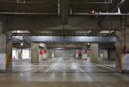 Parking garage underground interior, neon lights in dark photo