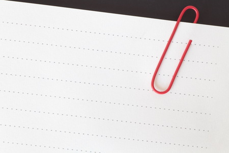 Blank paper note and red metal paperclip Stock Photo