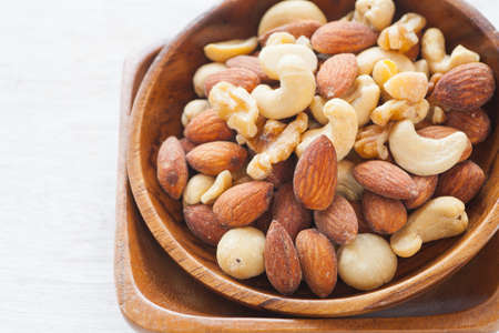 Close - up Mix of nuts on white background photo