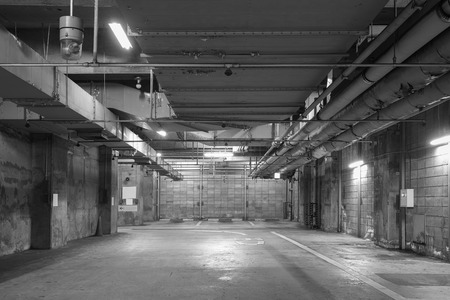 car park interior: Empty space of underground car parking at night time