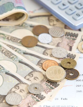 Close - up Japanese yen banknotes and Japanese yen coin photo
