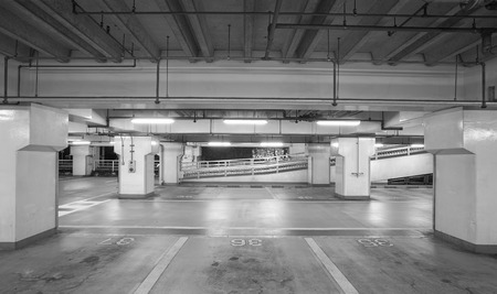 Empty space of underground car parking at night time photo