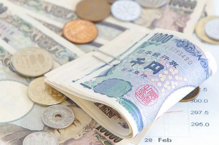 yen: Close - up Japanese yen banknotes and Japanese yen coin Stock Photo