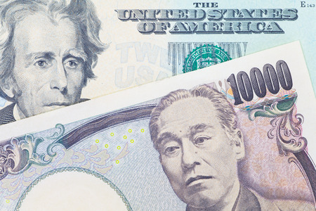 Japanese yen currency and dollar bank note use for currency concept photo