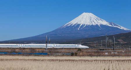 Bullet train Tokaido Shinkansen with view of mountain fuji at Shizuoka prefecture , Japan photo