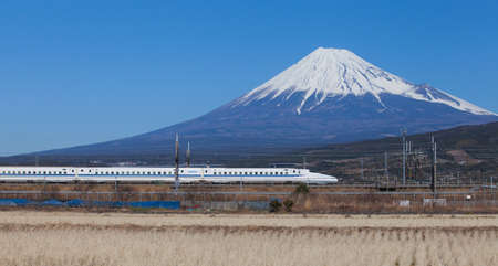 Bullet train Tokaido Shinkansen with view of mountain fuji at Shizuoka prefecture , Japan