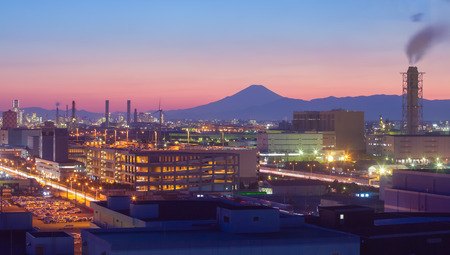 Mountain Fuji and Japan industry zone from Kawasaki city at twilight time photo