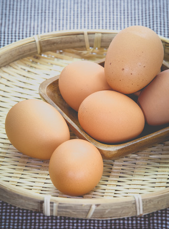 Healthy food brown chicken egg on bamboo tray