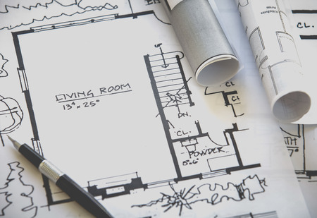 architectural plan: Architect rolls and plans construction project drawing