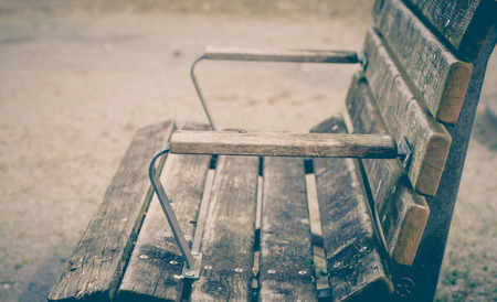 wooden bench: Empty vintage old wooden bench at public playground Stock Photo