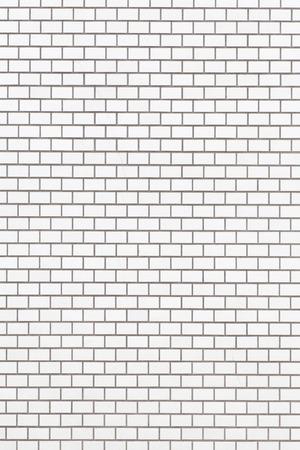 White brick stone wall seamless background and texture photo