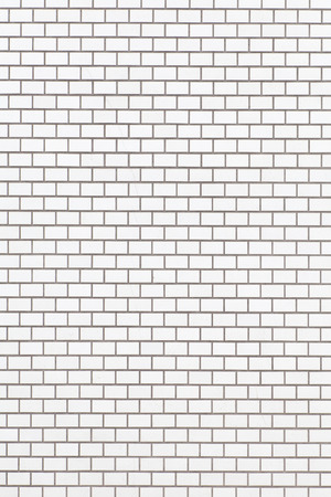 White brick stone wall seamless background and texture photo