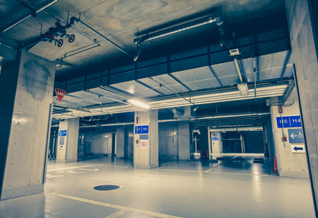 parking lot interior: Empty space of underground car parking at night time