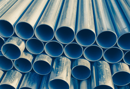Close - up Stack of construction metal pipes photo